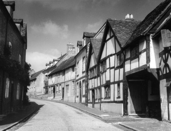 Mill Street, Warwick, with a row of Tudor half-timbered houses, a glimpse of Shakespeare's England. Date: 16th century