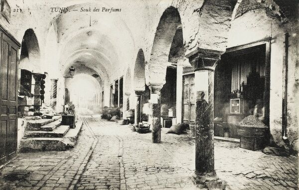 The Covered Perfume Market - a fabulous arcaded structure with shops and stalls set back from a main thoroughfare lined with columns and round arches