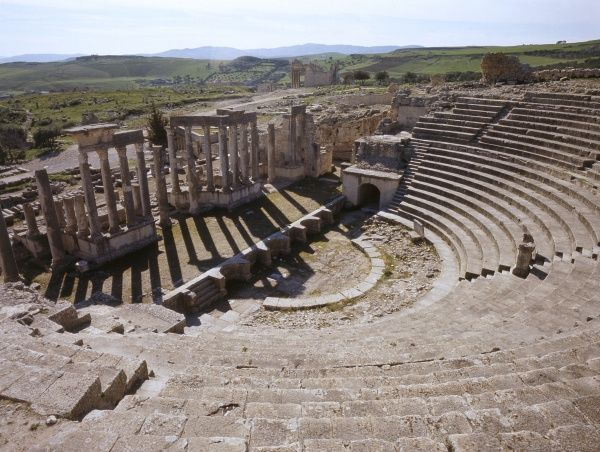 The Roman Theatre at DOUGGA, Tunisia. Dougga served as one of the capitals of Massinissa, a Roman ally, and one of the contenders to Carthage. Date: 1985