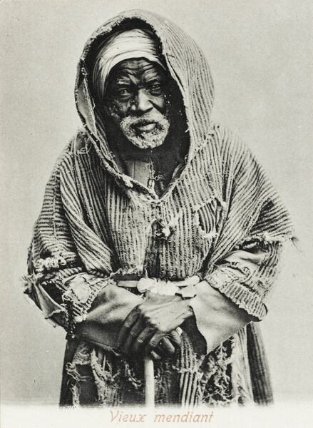 A fine photograph of an old Tunisian beggar in rags