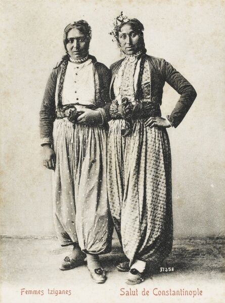 A pair of Turkish Gypsy twins in traditional costume