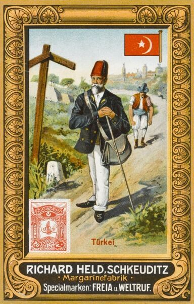 A Turkish postman with satchel and long stick checks a signpost to make sure he is delivering to the correct address!