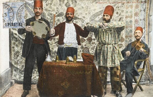 A fine Turkish musical quartet, including a tamborine player, a violinist, a gentleman playing some sort of pipe (similar to those used by snake charmers) and a fourth gent (second from left) doing something or other!
