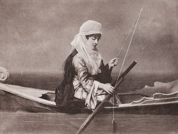 A Turkish woman in a small rowing boat does a spot of quiet fishing near Constantinople