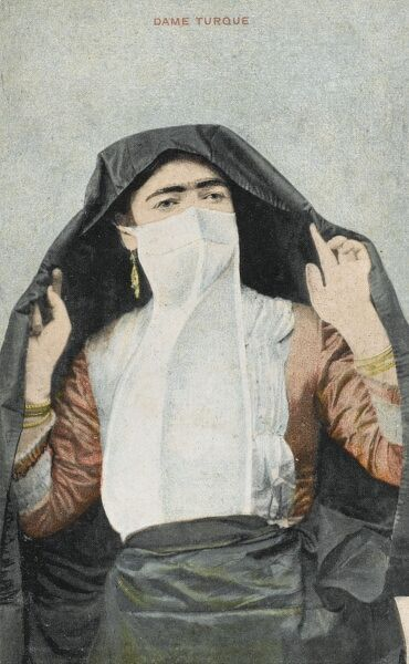 A postcard from Egypt depicting a Turkish Ottoman Woman wearing a long white veil