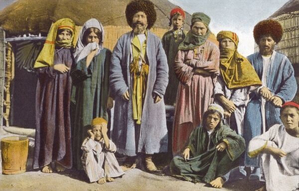 Turkmenistan - Family group standing amid their yurt tents Date: circa 1903