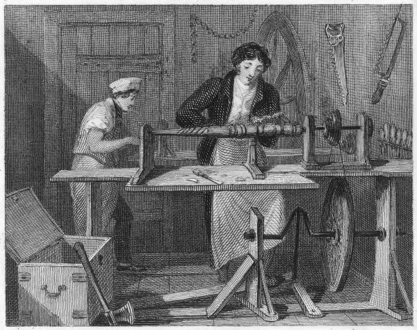 A turner uses a lathe powered by a foot pedal to carve and shape a length of wood