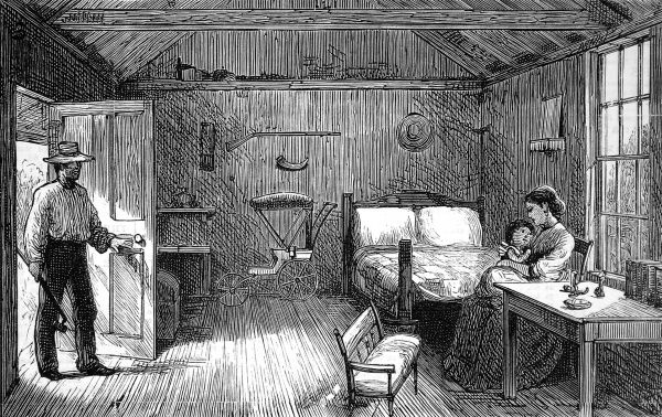 Interior of a Tuscarora American Indian village hut. The Indian hut betrays nothing pertaining to native Indian culture, being bare apart from a perambulator and double bed. Date: 1876