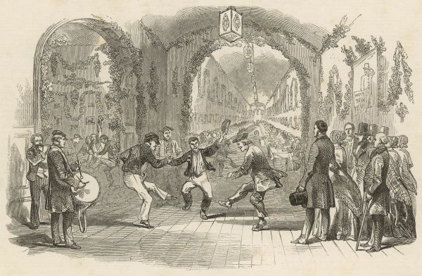 Inmates of the Hanwell Lunatic Asylum, a pioneering institution for the Victorian age which operated a non-restraint policy, dance together joyfully in one of the decorated wards on the evening of January 6th 1848 (Twelfth Night)