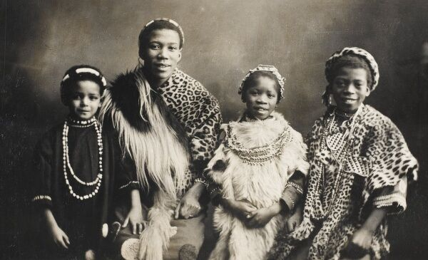 The happy Family of the Omukama of Toro, Uganda, wearing beads and leopard/cheetah skins