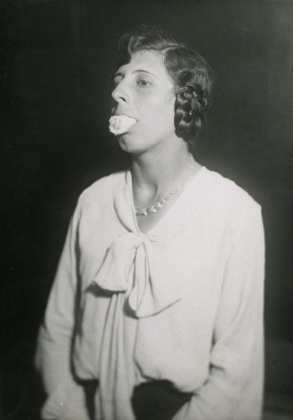 Undated photograph of Ethel Beenham with six feet of 30 inch wide cheesecloth in her mouth, showing how easily it can be rolled up and secreted in the mouth