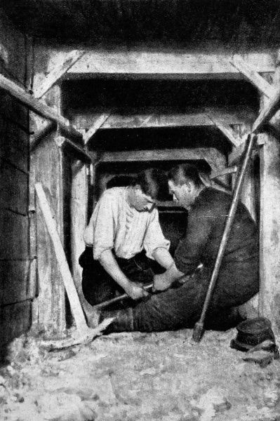 Men working a mine-drill in a gallery, making a bore-hole for a 'camoflaut' or secondary chamber, intended to cause the enemy work to fall in