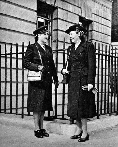 Pictured on the left, a single-breasted dark green serge suit, on the right a dark green overcoat. Uniforms designed for state enrolled assistant nurses