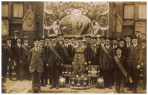Members of the Bermondsey branch of the National Union of Railwaymen pose for a photograph with their 'Workers of the World Unite' banner and their marching drums