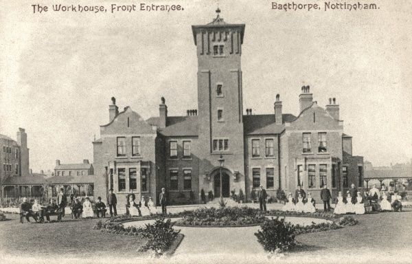 Front entrance of the Nottingham Union Workhouse at Bagthorpe, Nottingham, with staff seated outside. Designed by Arthur Marshall, the workhouse and its accompanying large infirmary were opened in 1903. The site later became Nottingham City Hospital