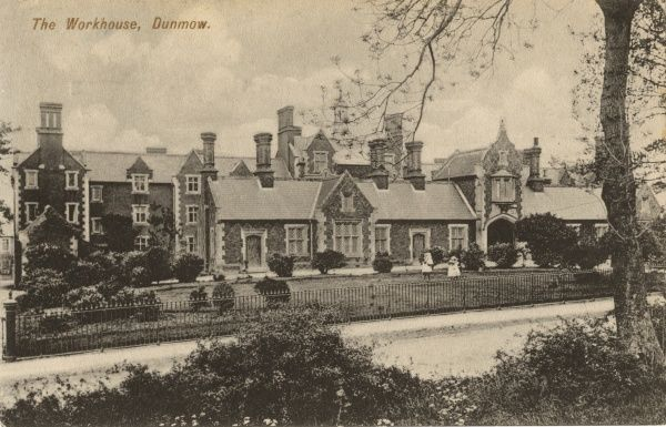 The Dunmow Union workhouse at Great Dunmow, Essex. Two children play in front of the building. The workhouse, erected in 1838-40, was designed by George Gilbert Scott and William Bonython Moffatt