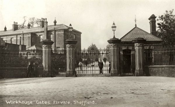 The gates of the Sheffield Union workhouse at Fir Vale in South Yorkshire, with the workhouse porter standing behind