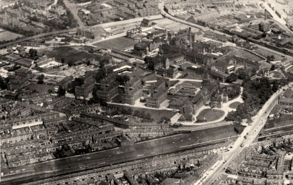 Aerial view of the Birmingham Union workhouse and infirmary on Dudley Road, Birmingham. The workhouse, opened in 1852, is the cross-shaped building just above right of centre of the picture. The parallel blocks of the Union infirmary, dating from 1888