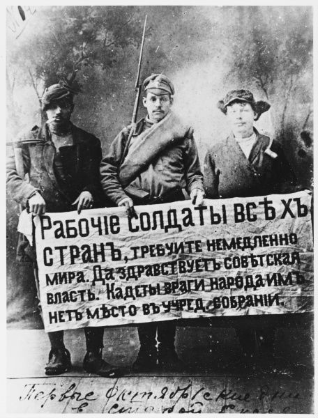 To symbolise the breadth of support for the Revolution, a worker, a soldier and a peasant pose with a banner which says, more or less, long life to Soviet Power