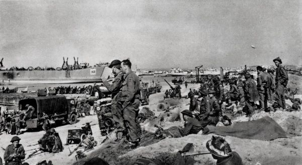 Photograph showing the unloading of supplies onto one of the Normandy beaches, shortly after the Allied invasion on 'D-Day', 6th June 1944