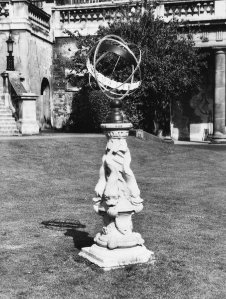 An unusual armillary sphere sundial with a base with fish sculpted into it, at Bath, Somerset, England