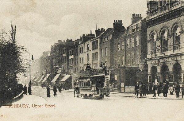 The top end of Upper Street, next to the Highbury and Islington roundabout. The Cock Tavern (still there) is on the right and a horse tram is heading south toward the Angel