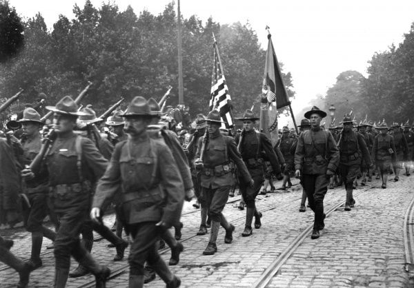 The arrival of the first American troops in Paris, France. Date: 1917