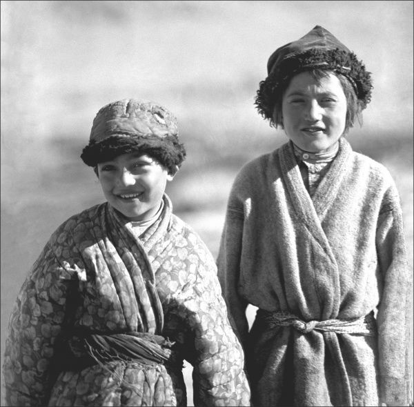 Two young Uyghur Children, close to Kashgar in Xinjiang, South West China. Photograph taken by Ralph Ponsonby Watts, who travelled up from Kashmir to Kahgar, thankfully recording his journey in a series of superb photographs