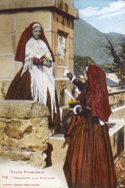 Val d'Ossau Women collect drinking water at the village fountain. Date: circa 1910s