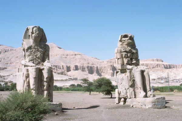 Valley of the Queens, Colossus of Menon, 2 statues of Amenophis III, 1417 - 1379 BC, orig. gate to Mortuary Temple. Photograph by Lionel Coates