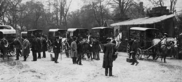 The sixth Van Horse Parade taking place on Easter Monday in Regent's Park, Central London. On the far left can be seen the Hon Alex E Parker judging an entry. This annual event was founded in 1904. In 1966 it merged with the London Cart Horse Parade
