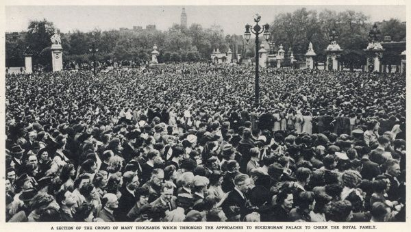 Crowds to welcome King George VI and Queen Mary as they appeared on the balcony of Buckingham Palace on May 8th 1945 (VE Day). The King and Queen would later be joined on the balcony by Winston Churchill