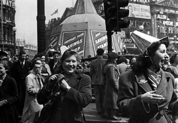 Jubilant scenes in Piccadilly Circus in Central London as crowds celebrate VE (Victory in Europe) Day on the 8th May 1945.  1945