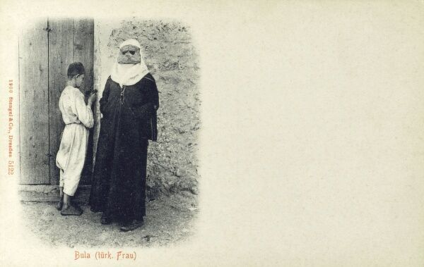 Veiled Turkish Woman and a young boy somewhere in the Balkan Region Date: 1908