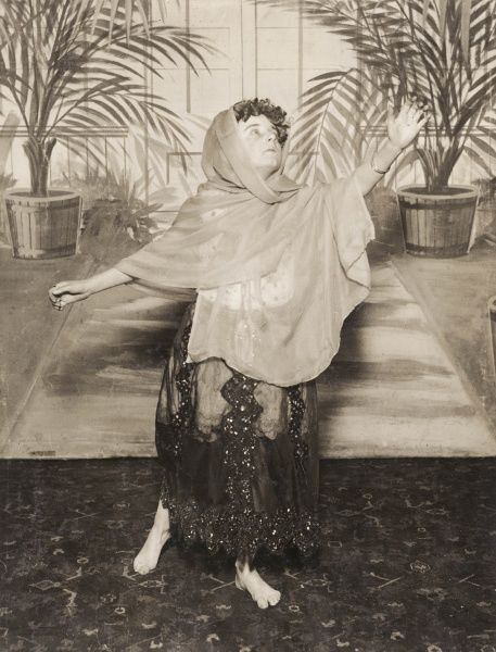 Vera Le Fleming (born c1901), a child ballet dancer and impersonator, performing in costume in front of a painted backdrop