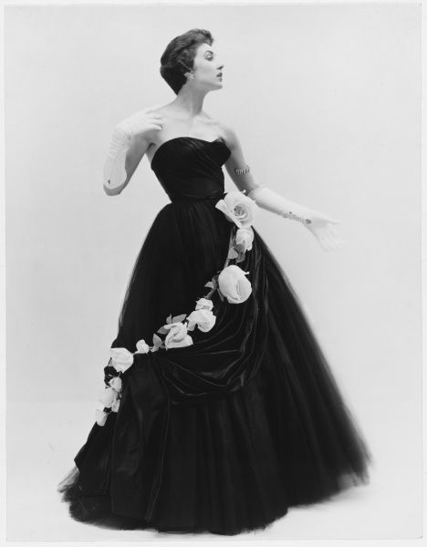 Design by Victor Stiebel (1907-1976) for a sumptuous strapless evening gown wtih a full skirt set off by a garland of roses