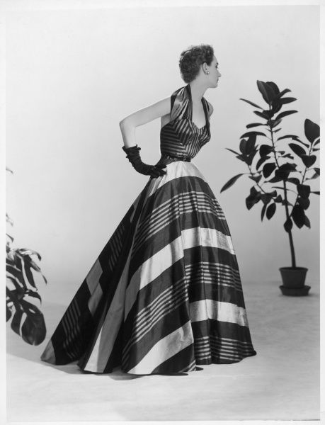 Design by Victor Stiebel (1907-1976) for a sumptuous striped silk evening gown with halter neck, belted waist and full skirt