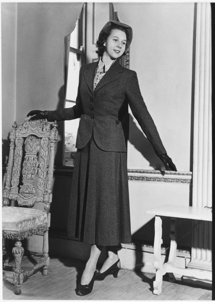 A suit of grey wood by Victor Stiebel at Jacqmar for Beryl Grey, ballet dancer at the Sadlers Wells Ballet Company during her American tour