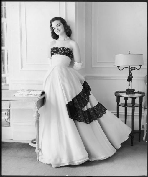 Portrait of Henrietta Tiarks, debutante of 1957, later Marchioness of Tavistock, now Dowager Duchess of Bedford wearing a Victor Stiebel gown trimmed with black lace