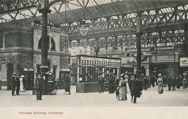 Victoria Station, Pimlico, London - Interior view with train departure boards and telegraph office