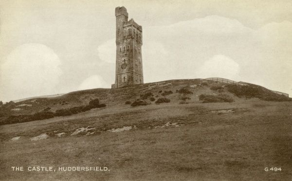 View of the Victoria Tower on Castle Hill, overlooking Huddersfield, Yorkshire. The tower was opened in 1899 to commemorate Queen Victoria's 60+ year reign. Date: 1940s