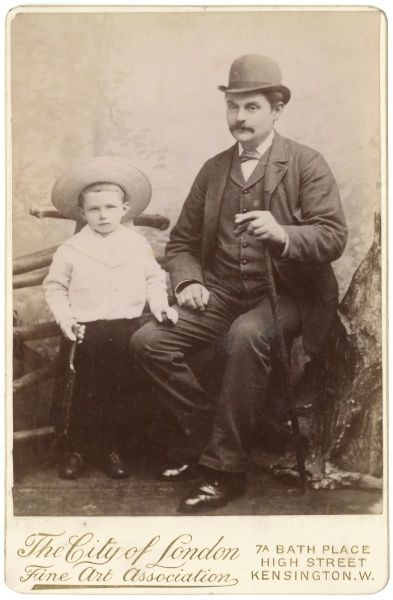 A Victorian father and his son pose for their photograph in the studio