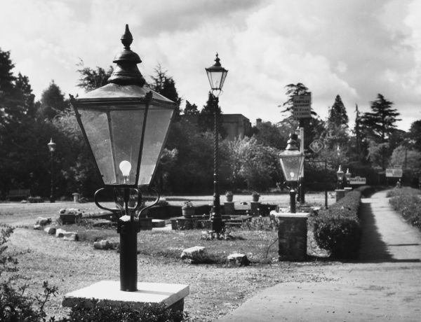 Examples of old Victorain street lamps now converted to electricity. These examples grace the entrance to a restaurant in Bagshot, Surrey