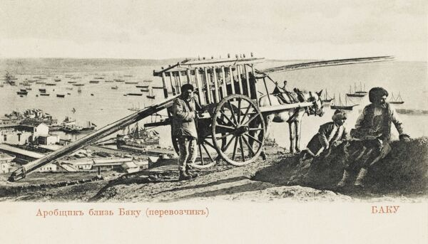 View of the Black Sea Coast at Baku, Azerbaijan, with a forground dominated by some local types and their empty horse-drawn high-sided cart