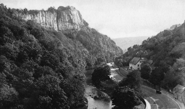 View of High Tor, a limestone crag which towers over Matlock Dale, Derbyshire. Date: circa 1920