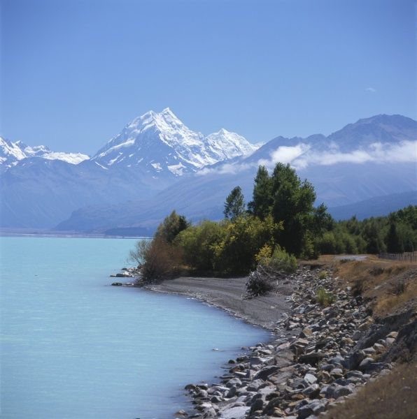 View of Lake Pukaki with Mount Cook (Aoraki) on the horizon, South Island, New Zealand. The lake is fed at its northern end by the Tasman River