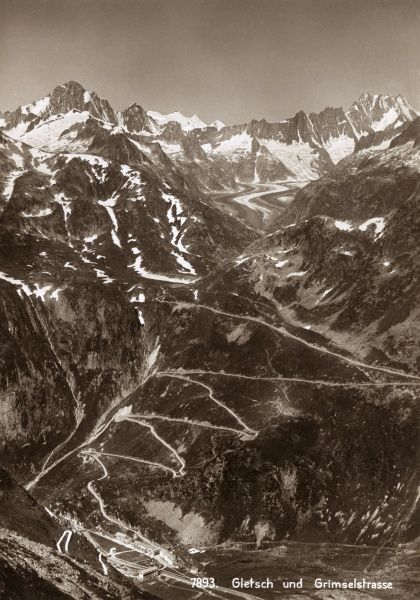 View of The Grimselstrasse, winding up the Rhone Glacier in the Swiss Alps. Date: circa 1940
