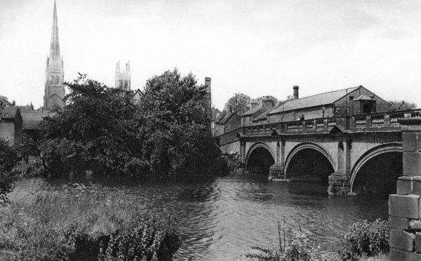 View of St Mary's Bridge, Derby, with the tall spire of St Alkmund's Church (now demolished) on the far left. Date: circa 1920