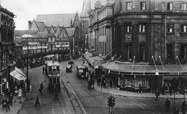 View of Victoria Street, Derby, with a tram and pedestrians. Date: circa 1920