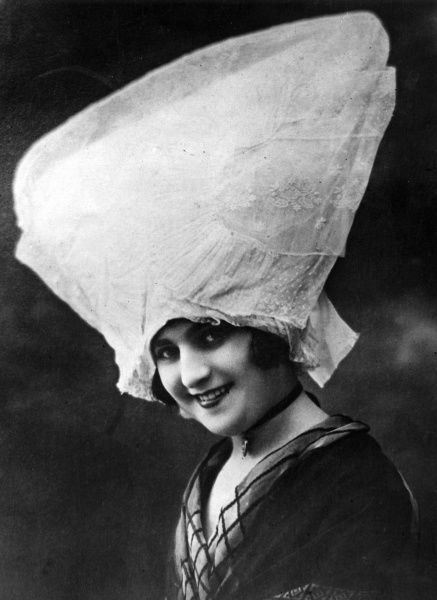 Mademoiselle Emile Langlor, the 'Queen' of the Charente vine growing district, in her striking, enormous, lace hat! Date: 1930s
